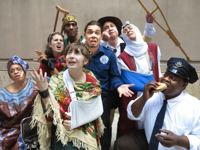 """EMERGENCY!!! or The World Takes A Selfie,"" a musical comedy about a New York EMT worker, will tour city streets, parks and playgrounds. A local performance will be held on Aug. 2 at 2 p.m. on First Ave. and 10th St. (Pictured) Foreground: Briana Bartenieff. L-R: Celeste Bradsher-Layne, Lily Frenaux, Terry Lee King, Justin Rodriguez, Primy Rivera, Danielle Hauser, Michael David Gordon (Photo by Jonathan Slaff)"