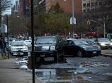 Cars parked on East 23rd Street and Avenue C got displaced by flooding from the storm. (Photo by Maria Rocha-Buschel.)