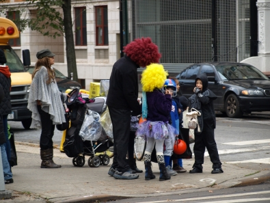 Halloween revelers didn't let the storm dampen their holiday spirit as children in costumes roamed the city, like these who were spotted outside Tompkins Square Park on Halloween, the Wednesday after the storm. (Photo by Maria Rocha-Buschel.)
