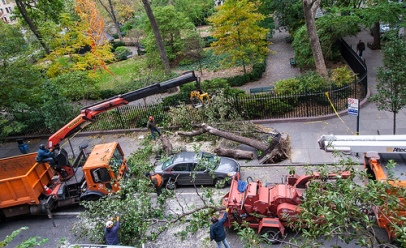 The cleanup effort underway at Gramercy Park. (Photo by Sean Brady.)