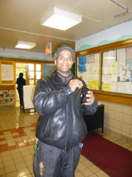 Campos Plaza resident Jose Loubriel with the radio that kept him company during the blackout. (Photo by Sabina Mollot.)