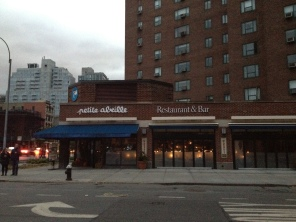 Petite Abeille on First Avenue was one of the few businesses to reopen after the storm, still unable to serve food and only lit by candles on the Wednesday right after Sandy hit. (Photo by Maria Rocha-Buschel.)