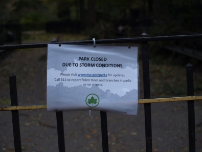 A sign posted outside Tompkins Square Park notifies residents that parks were not open due to the storm. (Photo by Maria Rocha-Buschel.)
