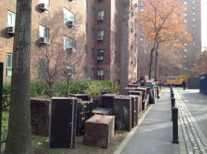 Workers stand by generators used to dehumidify building basements in Peter Cooper in late November.