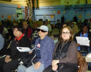 Residents of Stuyvesant Town and the East Village as well as postal employees and union reps packed a meeting on the planned closure of the Peter Stuyvesant Post Office on Monday. Photo by Sabina Mollot