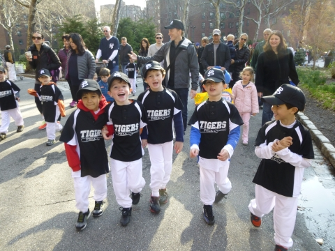 Members of the Peter Stuyvesant Little League and their families head out for the annual PSLL Parade on Saturday morning.