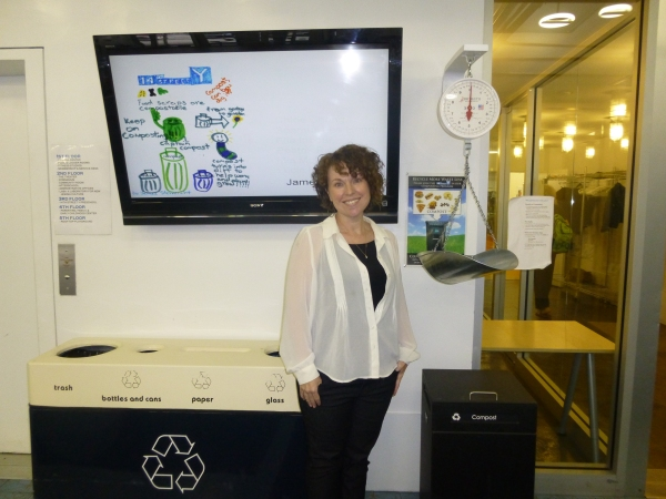 Camille Diamond, who runs the new composting program, in front of the Y's bin and scale Photo by Sabina Mollot