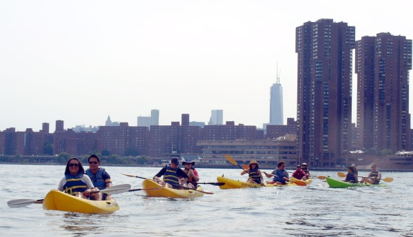 Kayakers with STPCV and Waterside Plaza in 2013 (Photo by Maria Rocha-Buschel)