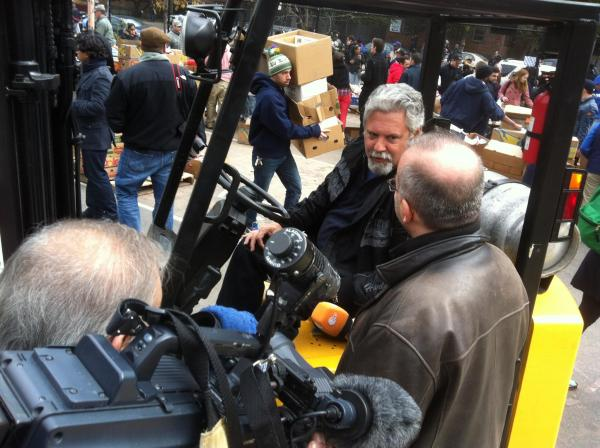 Richard del, Rio, not long after Hurricane Sandy, helps distribute food and supplies. Photo courtesy of Richard del Rio