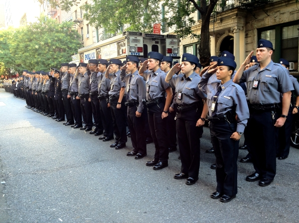 Police officers hold a ceremony outside the 13th Precinct on September 11, 2012. Photo by Maria Rocha-Buschel