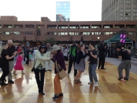 Residents boogie following a performance on the Plaza. (Photo by Sabina Mollot)