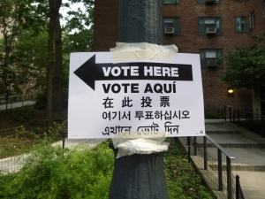 A sign in Stuyvesant Town, where one polling place was eliminated, points voters in the right direction. (Photo by Sabina Mollot)