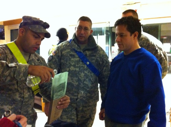 National Guardsmen give Council Member Dan Garodnick a demonstration on how to prepare packaged meals that were distributed to residents. (Photo courtesy of Dan Garodnick)