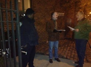 Tenants Association volunteer John Sicoransa talks to a neighbor on First Avenue. (Photo by Sabina Mollot)