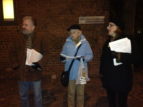 Tenants Association volunteers John Sicoransa, Judith Preble Miller and Anne Greenberg hand out fliers that urge tenants not to sign CWCapital's offer while outside 360 First Avenue, where an informational workshop on MCIs was being held. (Photo by Sabina Mollot)