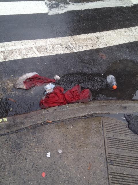 A Santa suit, or part of it, discarded at the corner of 23rd Street and First Avenue on Saturday (Photo by Mark Thompson)