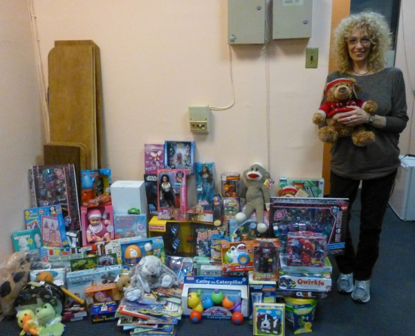 Bonnie Robbins, coordinator of children and family services at Beth Israel, with some of the toys at her Second Avenue office (Photo by Sabina Mollot)