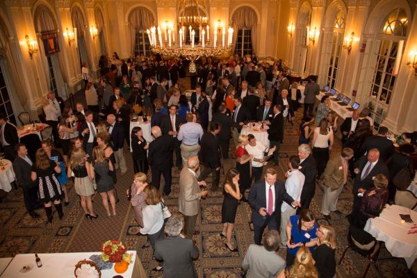 Guests, mainly alumni, pack a reception for the 125th anniversary of the school, held in November. (Photo courtesy of Epiphany School)