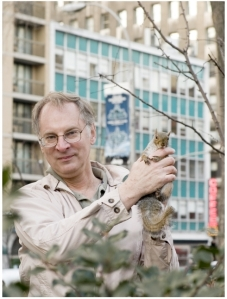 Squirrel rehabilitator Bernie Goetz with a fluffy-tailed friend in Union Square Park (Photo courtesy of Bernie Goetz)