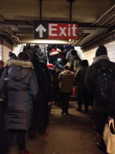 Straphangers head upstairs to exit the First Avenue L station on a recent morning. (Photo by Maria Rocha-Buschel)