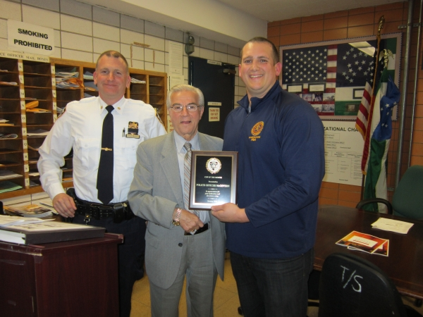 The Cop of the Month for April 2014 was awarded to P.O. Phil McGovern at the meeting of the 13th Precinct Community Council on April 15.  Pictured are Deputy Inspector David Ehrenberg, Council President Frank Scala, and P.O. McGovern. (Photo by Pat Sallin)