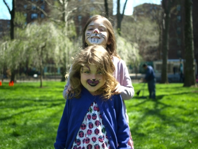 Five-year-old Eleanor Bradford and her sister 6-year-old Molly Bradford, Peter Cooper residents, show off their face paint