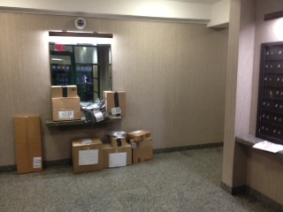 Packages recently piled up in the lobby of Council  Member Dan Garodnick's building in Peter Cooper Village. (Photo by Dan Garodnick)