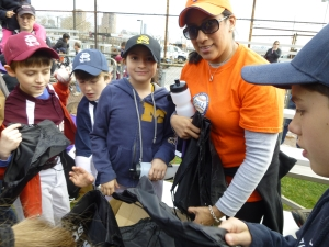 Jennifer Kops, pictured with daughter Kiki at a Peter Stuyvesant Little League Parade in 2013, has moved within ST/PCV three times in four years. (Photo by Sabina Mollot)