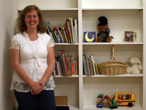 Open Arms Director Misa Anderson in one of the new preschool's classroom spaces (Photo by Maria Rocha-Buschel)