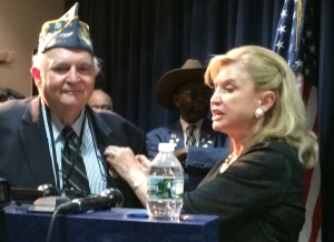 Congresswoman Carolyn Maloney pins a medal on Jerry Alperstein's jacket during a ceremony on Tuesday. (Photos by Sabina Mollot)