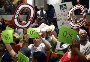 Tenants display signs at Cooper Union's Great Hall. (Photo by Maria Rocha-Buschel)