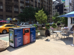 New recycling bins with solar-powered trash compactors have been installed in the Flatiron pedestrian plaza. (Photo by Sabina Mollot)