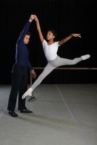 Dance student jumping with teacher (Photo by Christopher Duggan)
