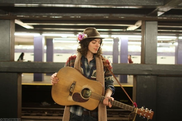 Singer and songwriter Robert Leslie in a promo photo on the subway (Photo by TheDustyRebel)