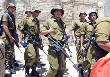 Israeli soldiers smile for the camera. (Photo by Maria Rocha-Buschel)