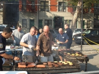 Former 13th Precinct Executive Officer Frank Sorensen and other cops man the grill at the event, held at the Simon Baruch Middle School playground.
