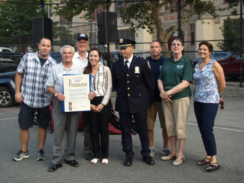 (From left) Police Officer John Considine, 13th Precinct Community Council President Frank Scala, Assemblyman Brian Kavanagh, Rebecca Lynch, Captain Steven Hellman, Police Officer Vincent Arlotta, Community Council treasurer Pat Salin and event organizer Jo-Ann Polise