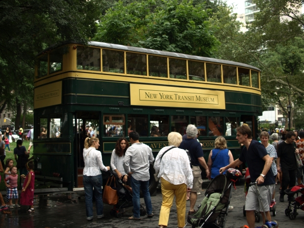 Park-goers visit the old double decker bus on display courtesy of the New York Transit Museum (Photo by Maria Rocha-Buschel)