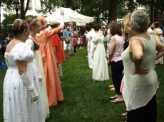 Costumed volunteers and attendees dance on the lawn (Photo by Maria Rocha-Buschel)
