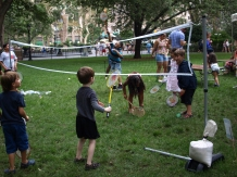 Kids play badminton on the lawn (Photo by Maria Rocha-Buschel)