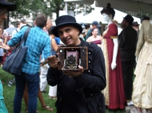 Museum of Interesting Things curator and founder Denny Daniel displays an old Kodak camera (Photo by Maria Rocha-Buschel)