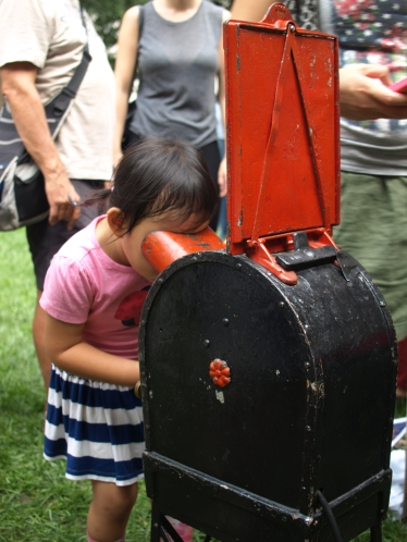 A young attendee tries out the mutoscope on display (Photo by Maria Rocha-Buschel)