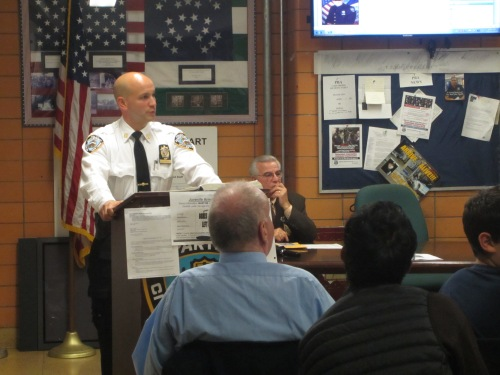 Captain Steven Hellman speaks at Tuesday's meeting of the 13th Precinct Community Council. (Photo by Maria Rocha-Buschel)