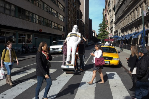 A statue of NSA leaker Edward Snowden gets wheeled into Union Square Park. Not long afterwards, the sculptor, Jim Dessicino, was told he had to remove it. (Photo by Brian Wagner)