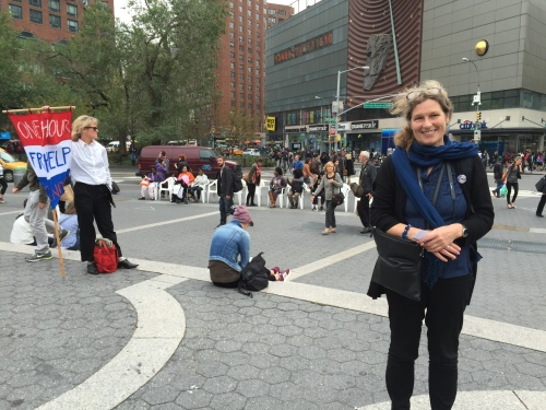 "Ienke Kastelein in front of her installation, ""Walking with Chairs"" at Union Square Park, was previously told to move on from a sidewalk in front of Stuyvesant Town. (Photo by Sabina Mollot)"