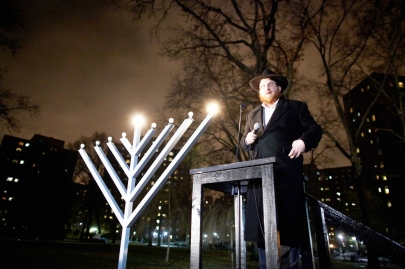 Rabbi Chezky Wolf leads a menorah lighting in Stuy Town in 2010.