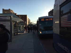 Three M15 buses line up alongside a bus stop in front of Stuyvesant Town on First Avenue. (Photo by Sabina Mollot)