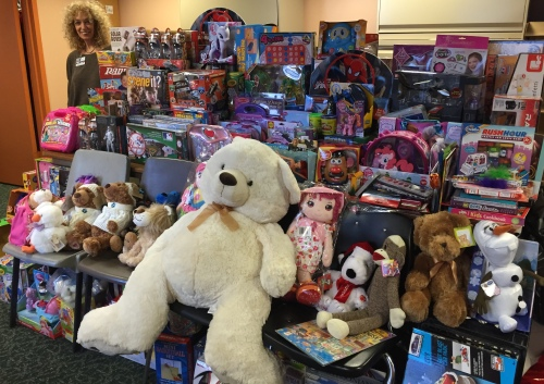 Bonnie Robbins, coordinator of children and family services at Mt. Sinai Beth Israel, stands by some of the donated toys. (Photo by Sabina Mollot)