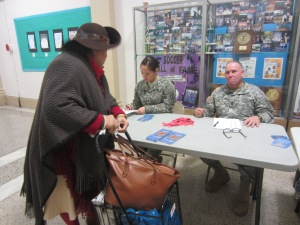 Alexandria Wiedenbaum and Sergeant Major Armando Lopez, helping people sign in and register for the training.  (Photo by Maria Rocha-Buschel)