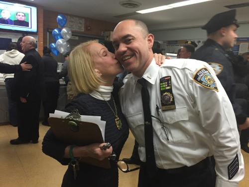 Gramercy Park Block Association President Arlene Harrison plants a kiss on Lieutenant Sammy Ponce of the 13th Precinct, where she  was one of the organizers of a luncheon last Thursday.